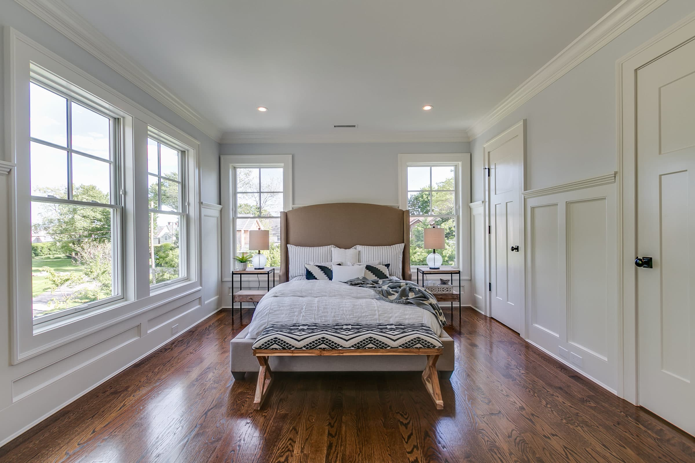 Master bedroom light blue walls and white wainscotting trim