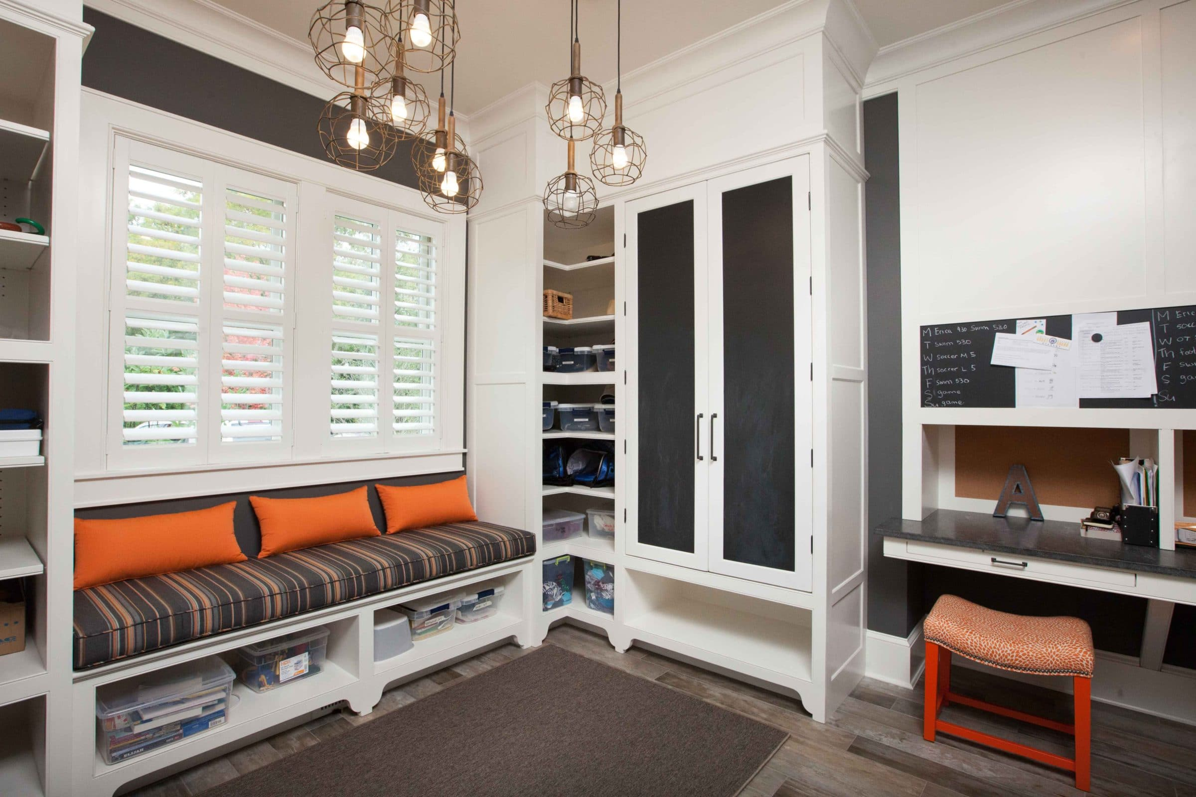 Mudroom with brown walls and white custom woodwork